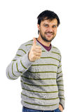 Smiling man giving thumbs up sign Royalty Free Stock Photo