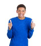 Smiling man giving two thumbs up Royalty Free Stock Photos