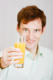 Smiling man with a glass juice Stock Images