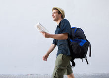 Smiling man going on vacation with bag and map Royalty Free Stock Photography