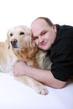 Smiling man with Golden Retriever Stock Image