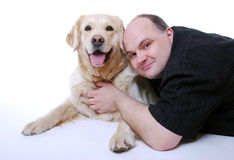 Smiling man with Golden Retriever Stock Images