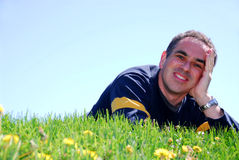 Smiling man on grass Royalty Free Stock Images