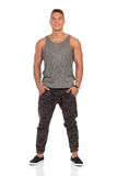 Smiling Man In Gray Tank Top And Camo Pants Royalty Free Stock Photography