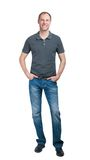 Smiling man in grey t-shirt and jeanse isolated on white backgro Stock Photo