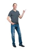 Smiling man in grey t-shirt and jeanse isolated on white backgro Royalty Free Stock Images