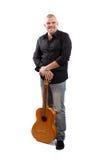 Smiling man with a guitar Stock Photos