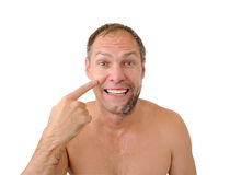 Smiling man half shaved Royalty Free Stock Images