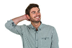 Smiling man with hand behind head Stock Images