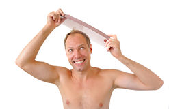 Smiling man hand holding comb on the head Stock Images