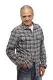 Smiling man with hand in pocket Stock Images
