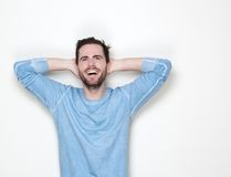 Smiling man with hands in hair looking up Royalty Free Stock Image