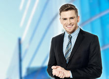 Smiling man with hands on his ears Stock Photo