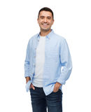 Smiling man with hands in pockets. Happiness and people concept - smiling man with hands in pockets Stock Images