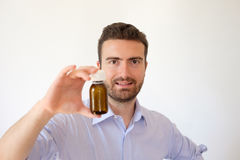 Smiling man happy with his medicines in his hand Royalty Free Stock Images