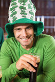 Smiling man with a hat toasting a beer Stock Image
