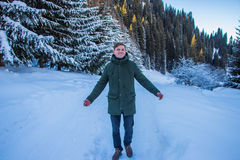 Smiling man have fun in the snowy mountains Royalty Free Stock Images