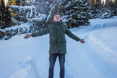 Smiling man have fun in the snowy mountains in winter Stock Photography