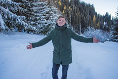 Smiling man have fun in the snowy mountains Royalty Free Stock Image