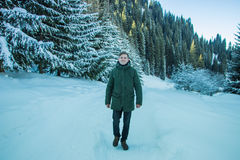 Smiling man have fun in the snowy mountains Stock Photos