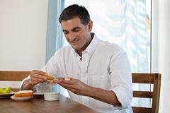 Smiling Man Having Breakfast Stock Photography