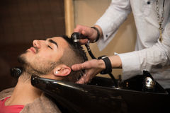 Smiling Man Having His Hair Washed At Hairdresser's Stock Photos