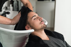 Smiling Man Having His Hair Washed At Hairdresser's Royalty Free Stock Photo