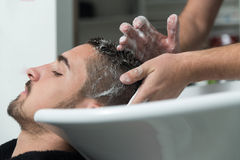 Smiling Man Having His Hair Washed At Hairdresser's Stock Photo