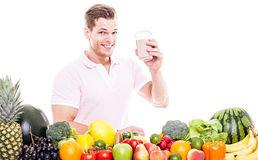Smiling man with healthy fruit vegetable drink Stock Images