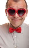 Smiling man with heart shaped glasses Stock Images