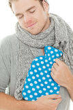 Smiling man with heating pad Stock Photos