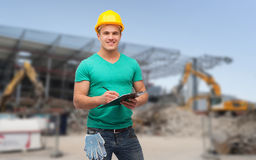Smiling man in helmet with clipboard Royalty Free Stock Photos