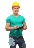 Smiling man in helmet with clipboard Stock Images