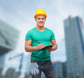 Smiling man in helmet with clipboard Stock Photography