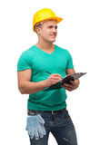 Smiling man in helmet with clipboard Royalty Free Stock Photo