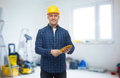 Smiling man in helmet with gloves over room Royalty Free Stock Photography