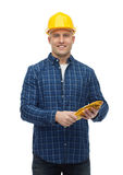 Smiling man in helmet with gloves Stock Photos