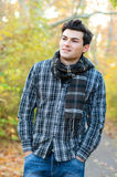 Smiling man hiking in autumn park. Stock Image