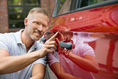 Smiling man with his new car Royalty Free Stock Photo
