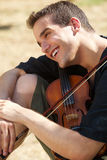 Smiling man with his violin Stock Photo