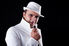 Smiling man with his white hat and coat Royalty Free Stock Photography