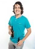 Smiling man hold beer bottle Stock Images