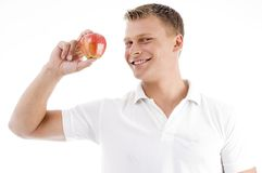 Smiling man holding apple Royalty Free Stock Image