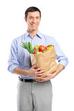 Smiling man holding a bag Stock Image