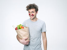 Smiling man holding a bag full of groceries Royalty Free Stock Photography