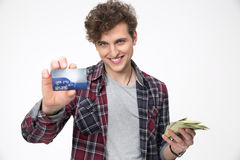 Smiling man holding banking card Stock Photos