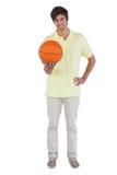 Smiling man holding a basket ball Royalty Free Stock Photos