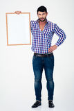 Smiling man holding blank board Royalty Free Stock Photography