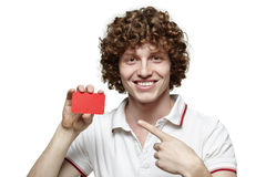 Smiling man holding blank credit card Royalty Free Stock Photos
