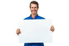 Smiling man holding board Royalty Free Stock Photography